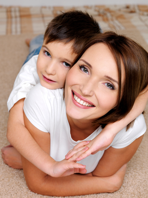 attractive young  happy smiling  mother  with her little son